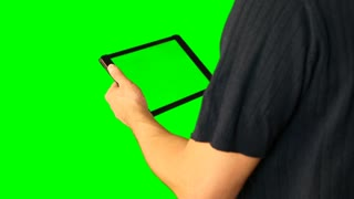 Man using tablet with green screen doubled on big screen 2 from 5. Chroma key green screen. HD.