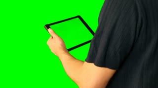 Man using tablet with green screen doubled on big screen.