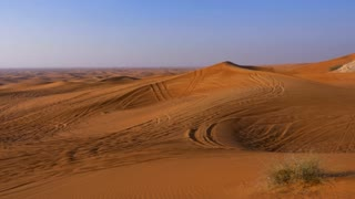 Panoramic view sand dunes and hills in hot desert. Wilderness desert landscape
