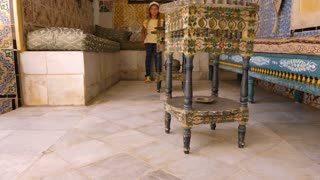 Sousse, Tunisia - June 15, 2018: girl visitor in Art Museum, located in palace in Medina Sussa. Mosaics in historical interior and architecture in Arabic style.