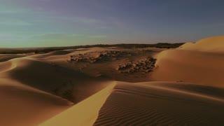 Sunset sunbeam desert slow motion view.