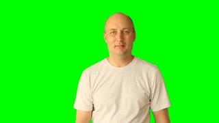 Very serious man close-up. Cheerful mature man shows gestures ok, excellent, good, wonderful. Finger up gesture with hands. Adult caucasian man gestures on green screen alpha channel.