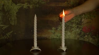 White candle burning , the repayment of the match , the flame of candles. Very slow motion