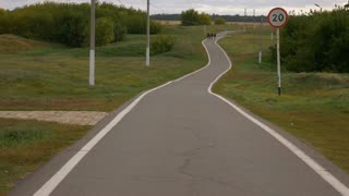 Winding long path way at country landscape.