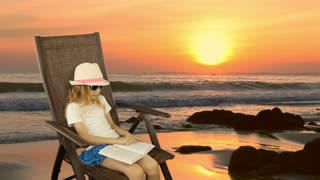 Young caucasian girl sitting on armchair and reading book. Orange sunset sea horizon coastline beach. Have same clip with transparent background Alpha Channel.