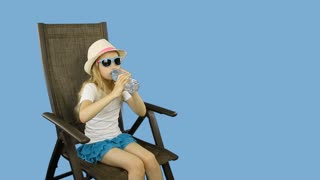Young caucasian girl sitting on chair and drinking still water then show thumbs up.