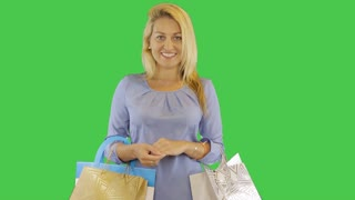 young woman walk with shopping bag at transparent alpha channel background. Front view.