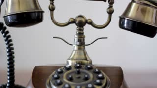 Close up of hand dialing a number and hanging up on the end