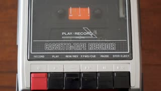 Insert cassette on old retro cassete tape recorder. Top view