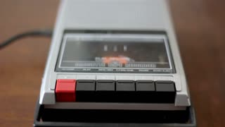 Put cassette playing on old retro cassete tape recorder