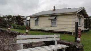 White wooden house in Maori Village