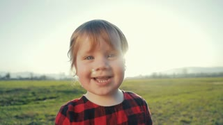 Baby-Girl Smiles straight to camera, Touches Camera lens, and asks for Food. First Steps. Emotions of happiness.