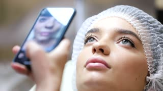 Cosmetologist Taking Photos on her Smartphone of Patient's Lips. Lips before the injection. The Procedure of Lip Augmentation of Hyaluronic Acid. Plastic Surgery. Series of Shots about Lip Augmentation