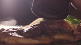 Extremely Close Up Shooting of Tobacco Chicken Dishes with Chefs Hands, Slow Motion. Chicken Steak in Tabaca Style Seasoning with Pepper, Salt, Rosemary. Tasty Food. Restaurant Menu. Fast Food.