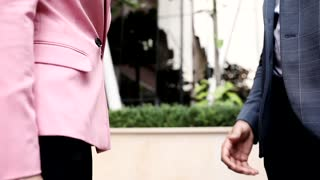 Handshake of Businessman and Businesswoman. Partnership Agreement. Close up of Business Partners Handshaking. Business Lifestyle. Deal. Official Meeting. Classical Suits. Collegues.