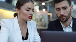 Portraits of Businesswoman and Businessman hard Working on a Laptop in Office. One Man Approaches the Other and They Have Discussion. Concentrating Work. Business Partners. Social Network.