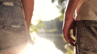 Romantic Young Couple Enjoying Time Together. Close up view of Man's Hand Holding Woman's Hand. Hand in Hand. Real Love. Pleasant Mood. Slow Motion. Few Shots. Series of Shots.