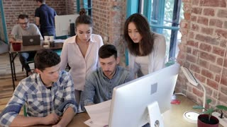 Start up Modern Office full of Office Workers. Viewing Charts and Graphs. Casual Dressed Collegues Having Meeting. Discussing Business Projects in Friendly Atmosphere. Developing Company.