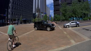4K Biker Crosses Street in Pittsburgh Tilt Up to US Steel Building 4402