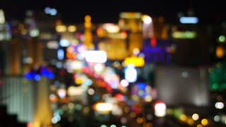 A blurred view of the Las Vegas Strip at night.