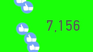 A close up shot of 100,000 likes being counted with thumbs-up icons on a social network page. Green screen.