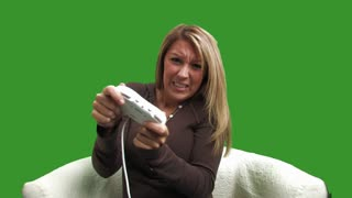 A college-aged girl plays a video game. Shot over green so you can key it over your own background.