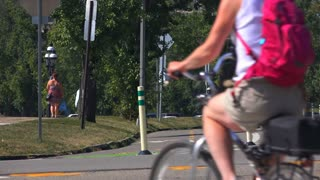 A college-aged male rides his bicycle near Schenley Park in the Oakland area of Pittsburgh, PA.  Shot at 60fps.