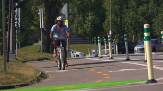 A college-aged male rides his bicycle through an intersection near Schenley Park in the Oakland area of Pittsburgh, PA.  Shot at 60fps.