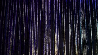 A colorful curtain background on a stage.