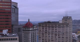 A day to night time lapse view over the city of Pittsburgh on an overcast winter day. DX.