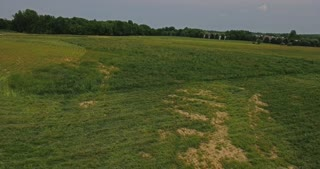 A daytime aerial view of a wide open Ohio field.
