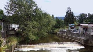 A daytime establishing shot of a dam near the fish hatchery in Issaquah, Washington.