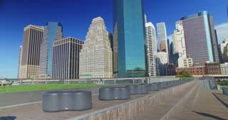 A daytime Manhattan skyline establishing shot as seen from Pier 15 East River Esplanade.