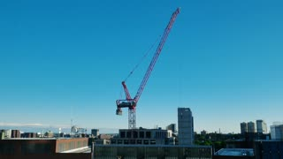 A daytime timelapse view of a crane working at a construction site in Boston.