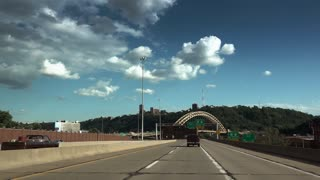 A driver's perspective of approaching the city of Pittsburgh on Route 65.