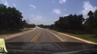 A driver's perspective of nearly hitting an oncoming truck as it passes slower vehicles.