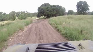 A driver's POV of riding in a backwoods trail in Texas on an ATV.