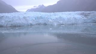 A foggy daytime establishing shot of Margerie Glacier in Glacier Bay, Alaska.