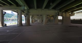 A forward perspective shot of driving through a cement parking structure in a big city. Part 2 of 2.