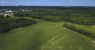 A high angle aerial view over corn fields on a Western Pennsylvania farm.