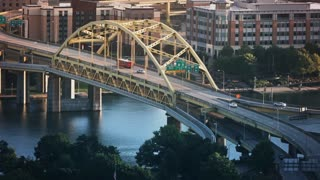 A high angle establishing shot of the Fort Duquesne Bridge in the city of Pittsburgh, PA.