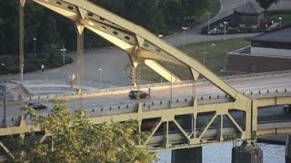 A high angle establishing shot of the Fort Pitt Bridge in the city of Pittsburgh, PA.