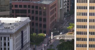 A high-angle view of light morning traffic on Broadway in downtown San Diego.