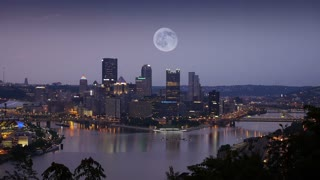 A large full moon over the city of Pittsburgh, Pennsylvania.