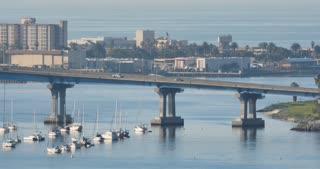 A long establishing shot of traffic on Coronado Bridge between San Diego and Coronado Island.