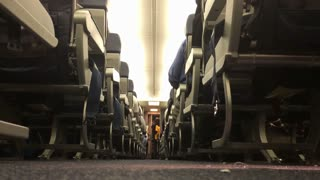 A low angle view of the Aisle of an airplane.