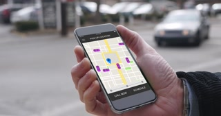 A man uses his smartphone to observe ride sharing traffic patterns on an interactive map in a fictional city.