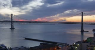 A morning sunrise time lapse over the San Francisco Bay Bridge.