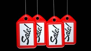 A motion background plate of a row of swinging sale red tags. With alpha channel.
