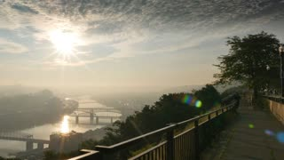 A pan from the overlook area of Mt. Washington to the skyline of Pittsburgh on an early summer morning.